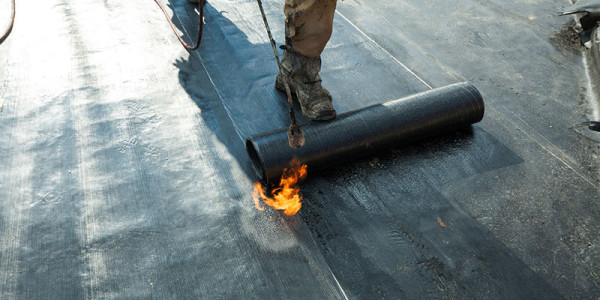 Installation of roll roofing waterproofing propane blowtorch dur